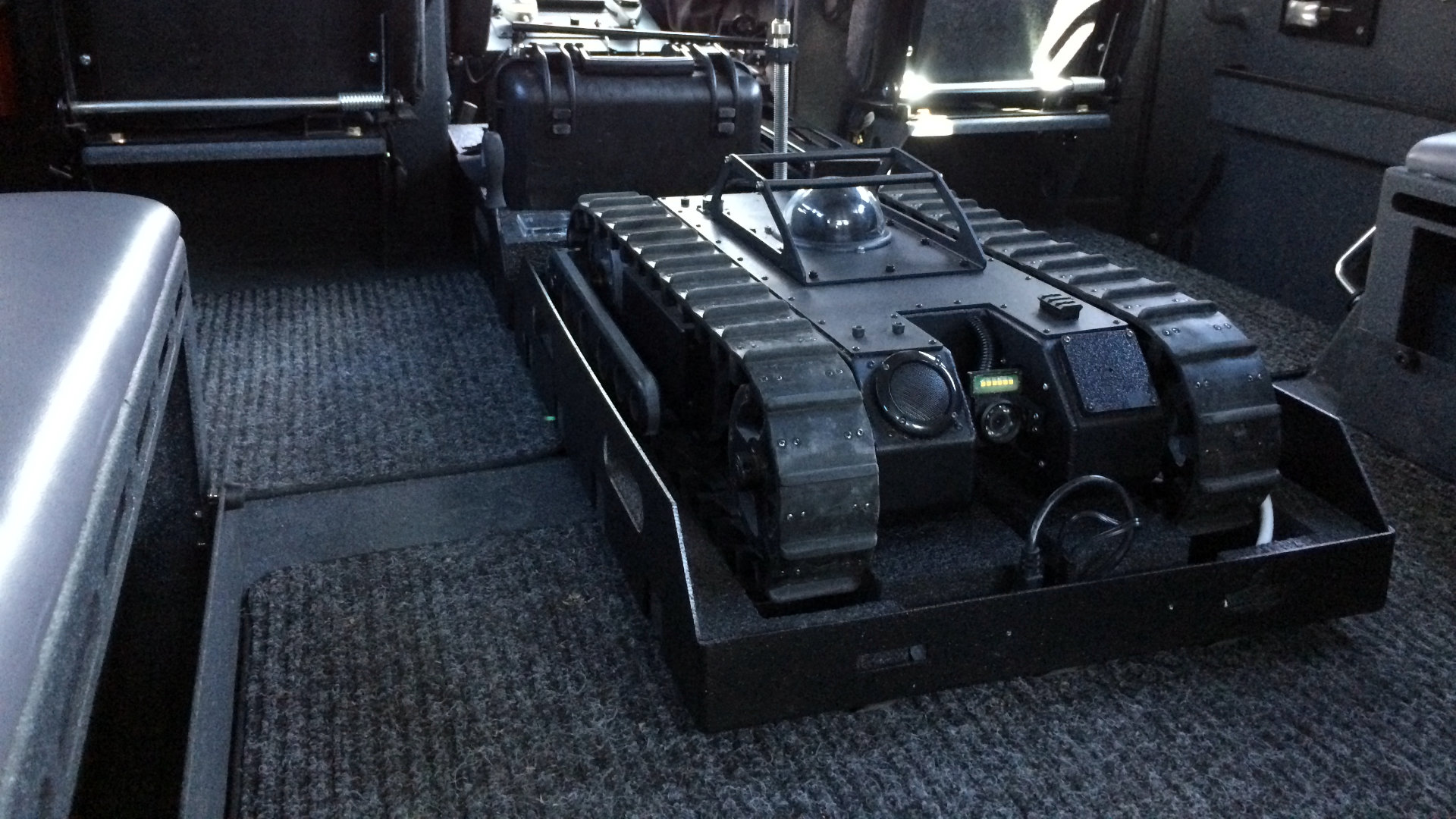 Compact tactical robot in SWAT vehicle