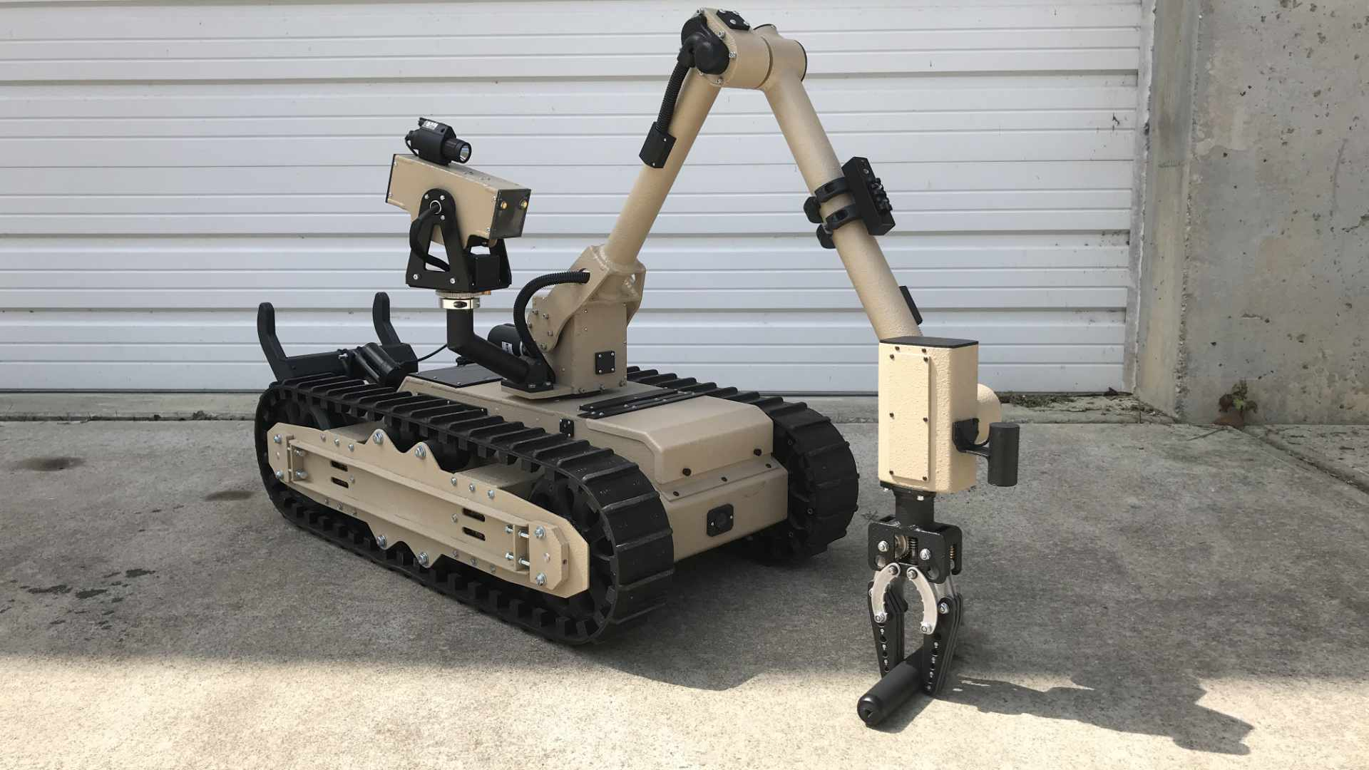 Mastiff Tactical Robot Manipulating Object
